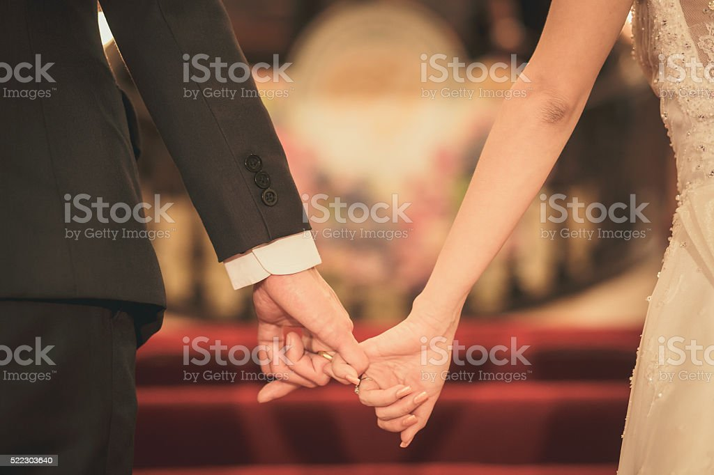Bride and groom holding hand waiting for wedding ceremony stock photo