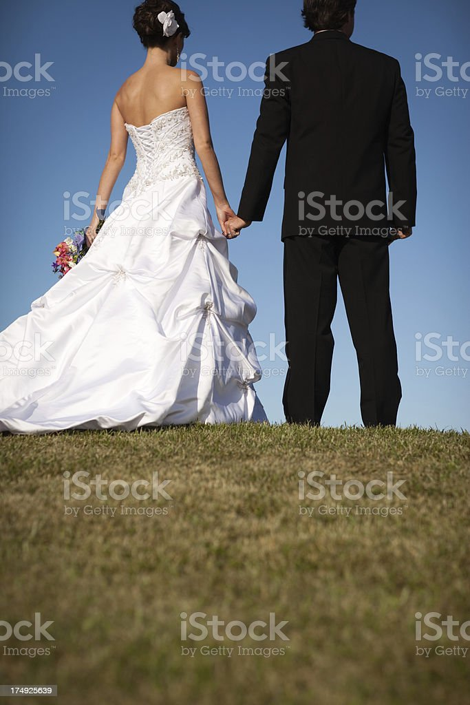Bride and Groom Holding Hands While Standing Outside royalty-free stock photo