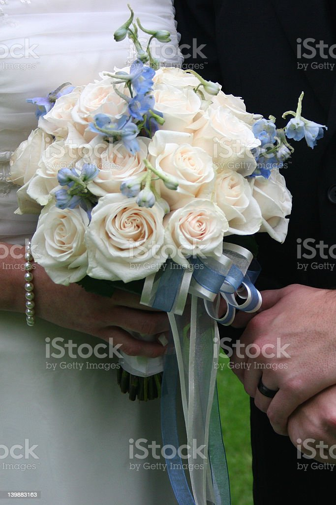 Bride and Groom holding wedding bouqet royalty-free stock photo