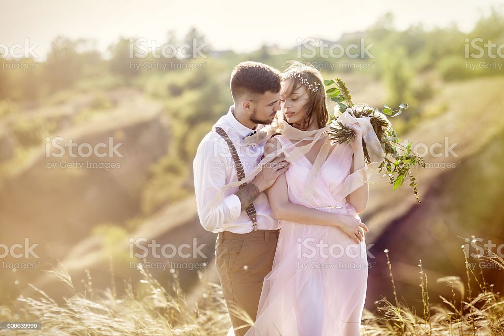 bride and groom hugging at the wedding stock photo