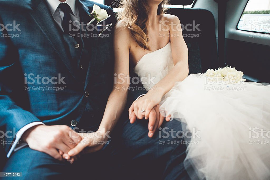 Bride and groom in a car stock photo
