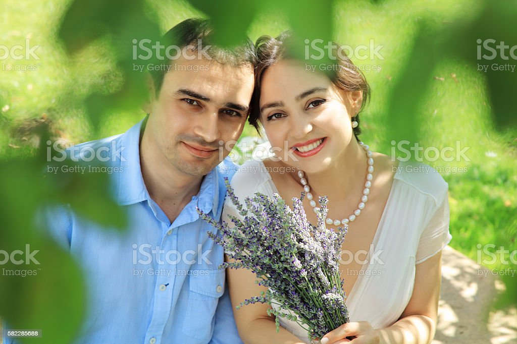 Bride and groom in a garden stock photo
