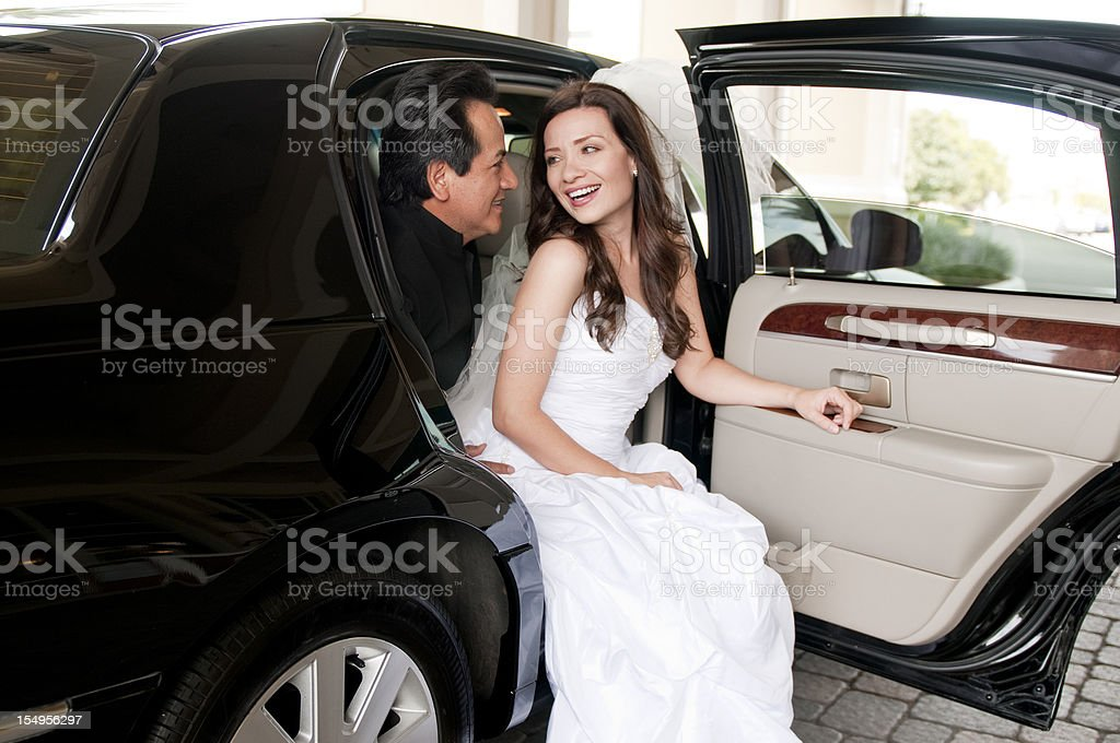 Bride and Groom in a Luxury Automobile stock photo