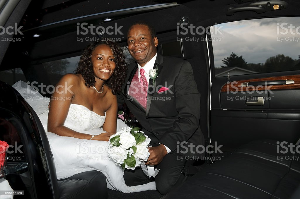 Bride and Groom in limo stock photo