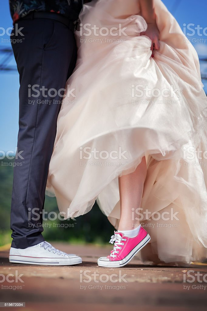 Bride and groom in sneakers stock photo