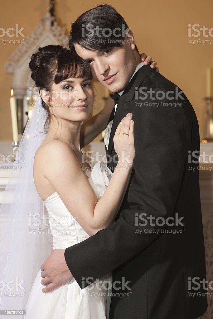 bride and groom in the church royalty-free stock photo