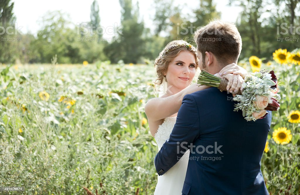 bride and groom in the nature on wedding day stock photo
