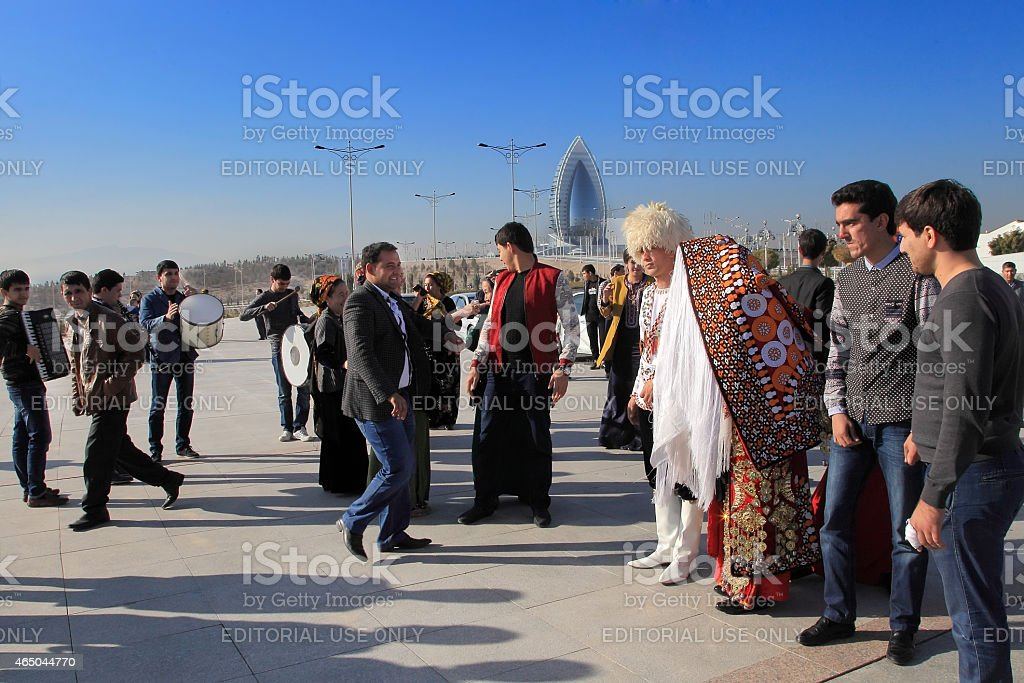 Bride and groom in the Turkmen national dress await guests. stock photo