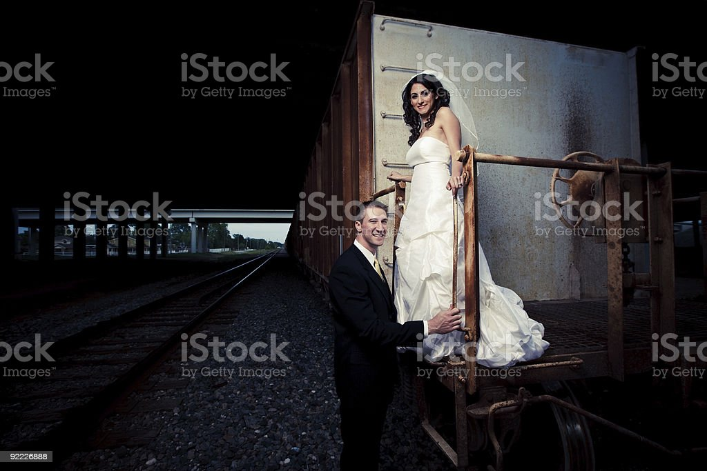 Bride and Groom in urban setting with Train Car royalty-free stock photo