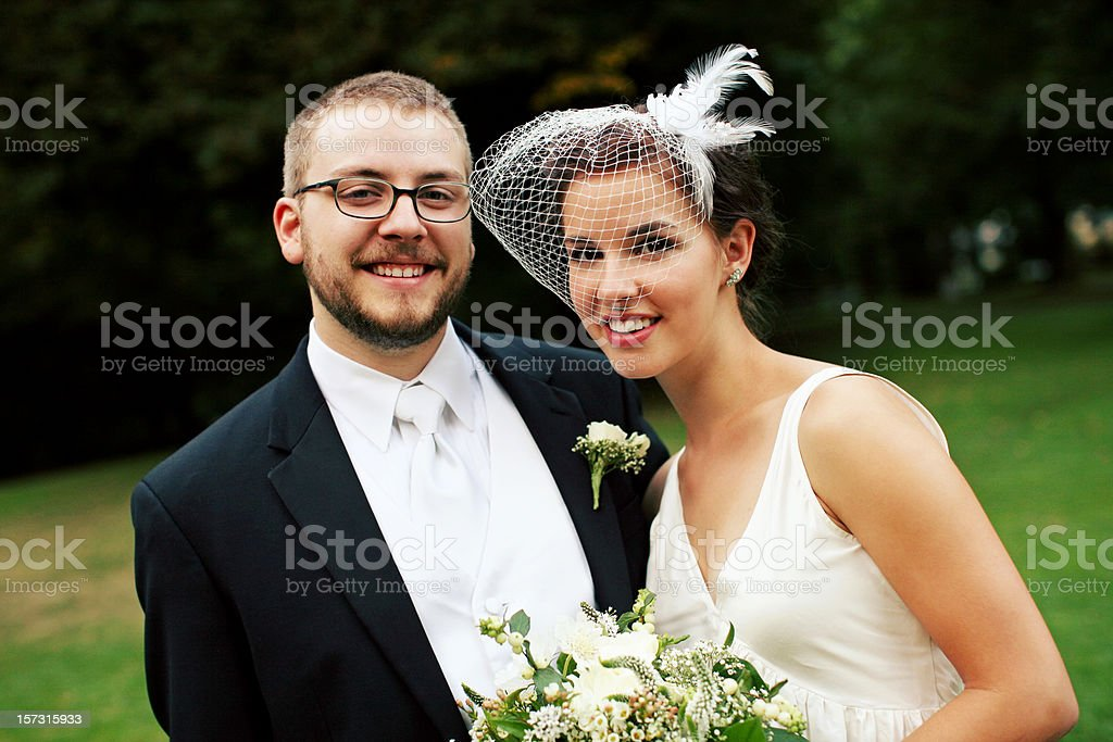 Bride and Groom in White at a Park royalty-free stock photo