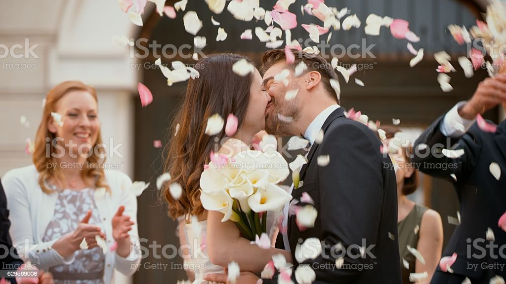 Bride and groom kissing stock photo
