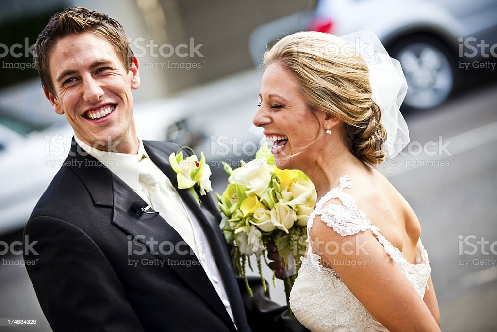 Bride and Groom Laughing Outside on Wedding Day royalty-free stock photo