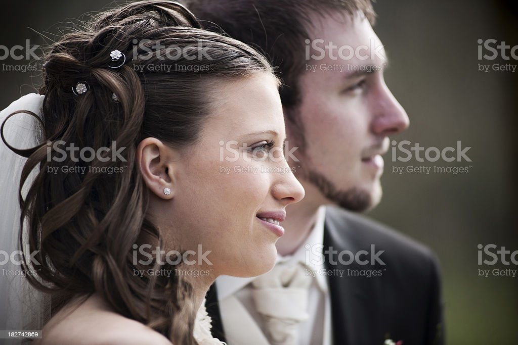 Bride and groom looking into the future royalty-free stock photo