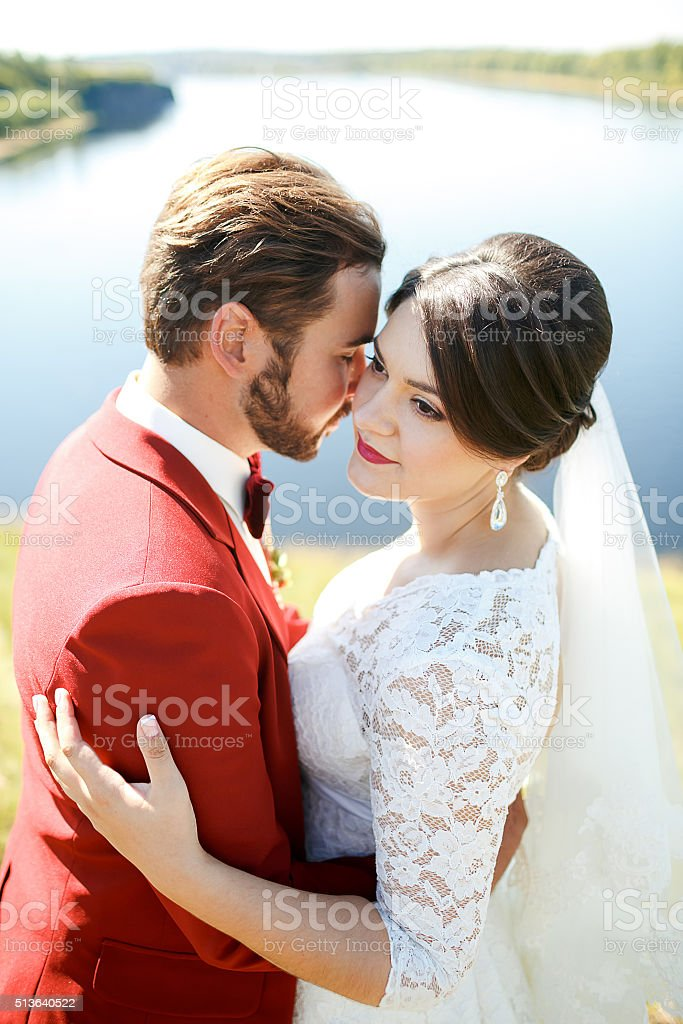 Bride and groom, lovely couple outdoor, river in background stock photo