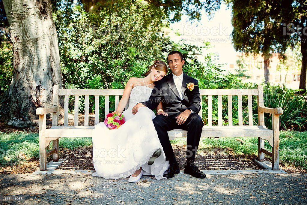 bride and groom on bench portrait royalty-free stock photo
