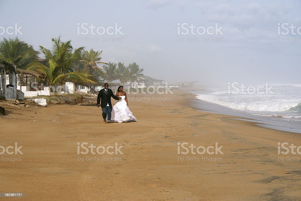 Bride and Groom on the Beach royalty-free stock photo