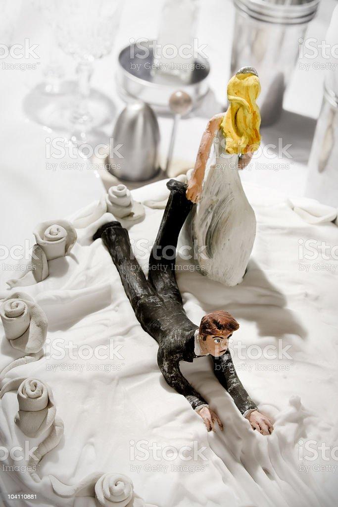 Bride and Groom on wedding cake stock photo