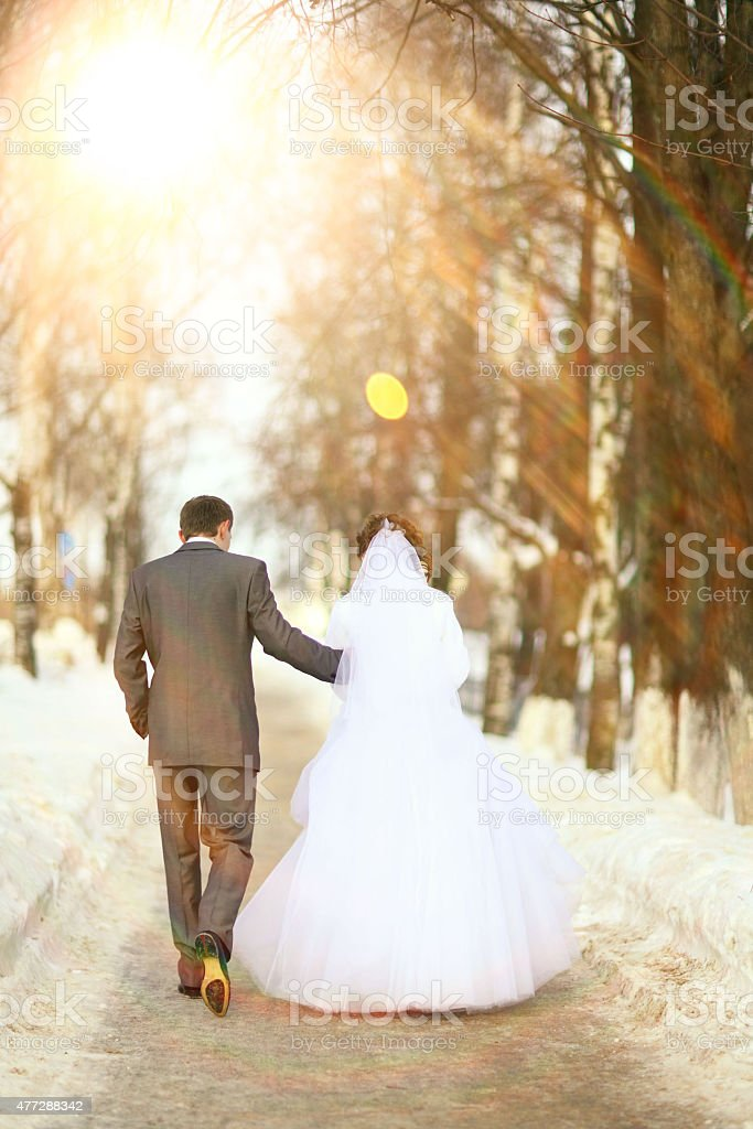 bride and groom outdoors in spring stock photo