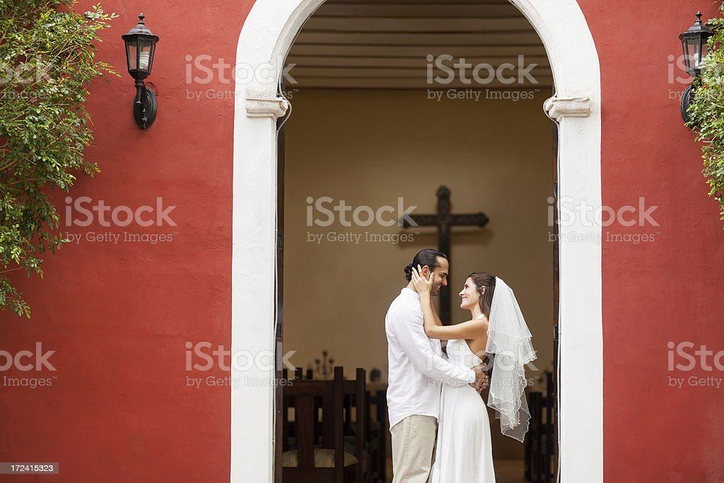 Bride and groom outside a church royalty-free stock photo