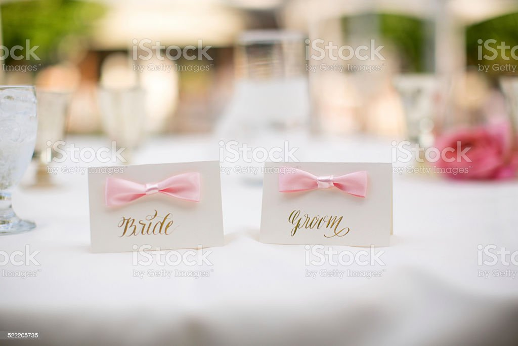 Bride and Groom Place Cards with flowers Wedding Reception stock photo