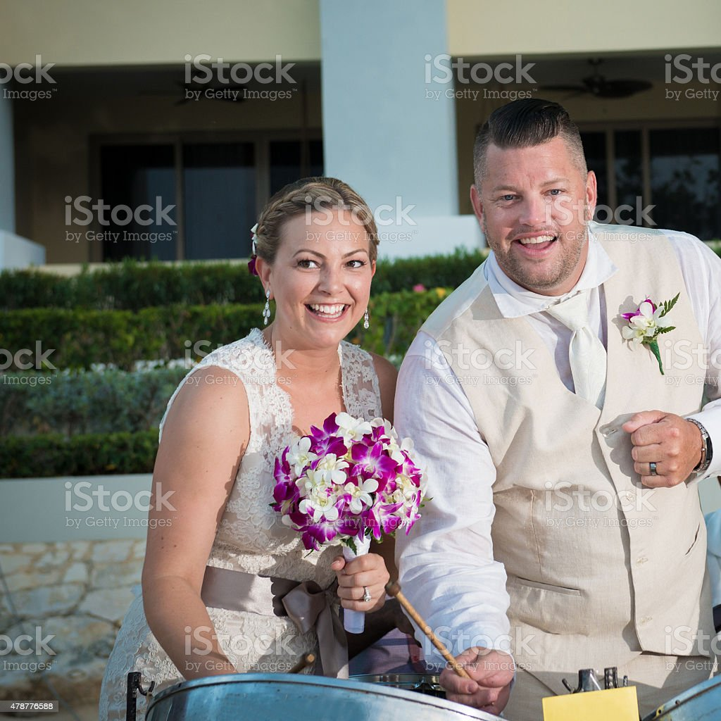 Bride and Groom playing  drums stock photo