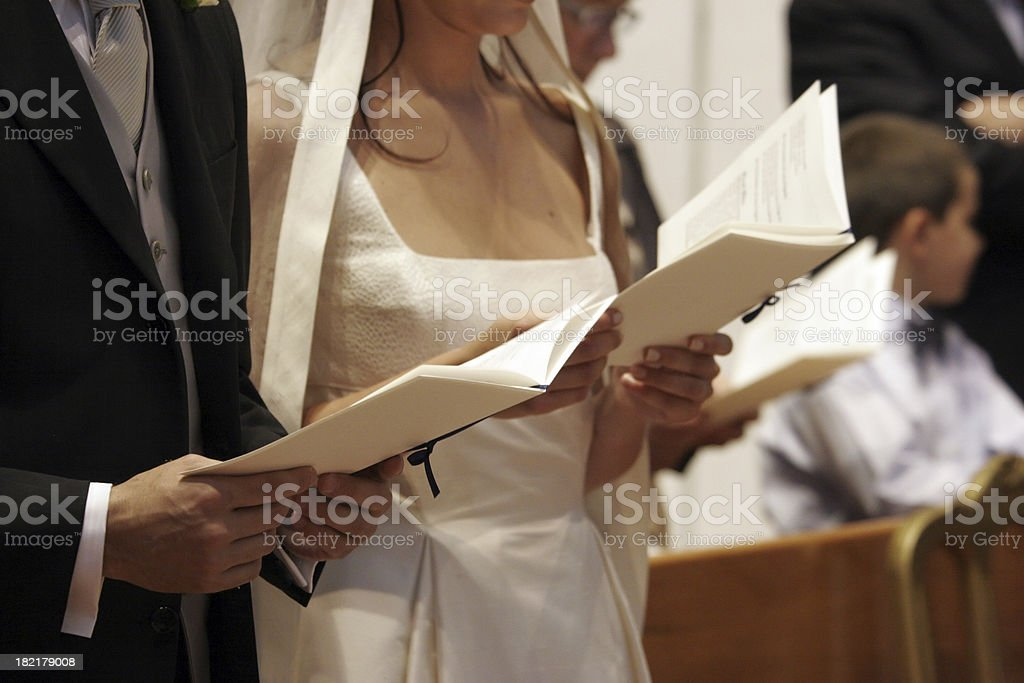 bride and groom praying royalty-free stock photo