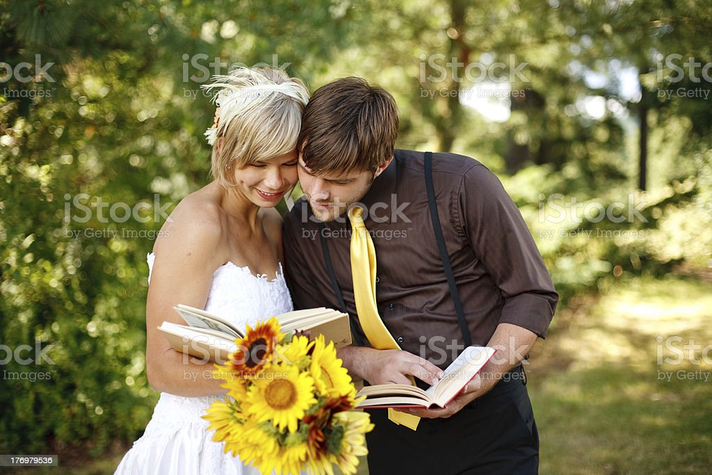Bride and Groom Reading Books Together stock photo