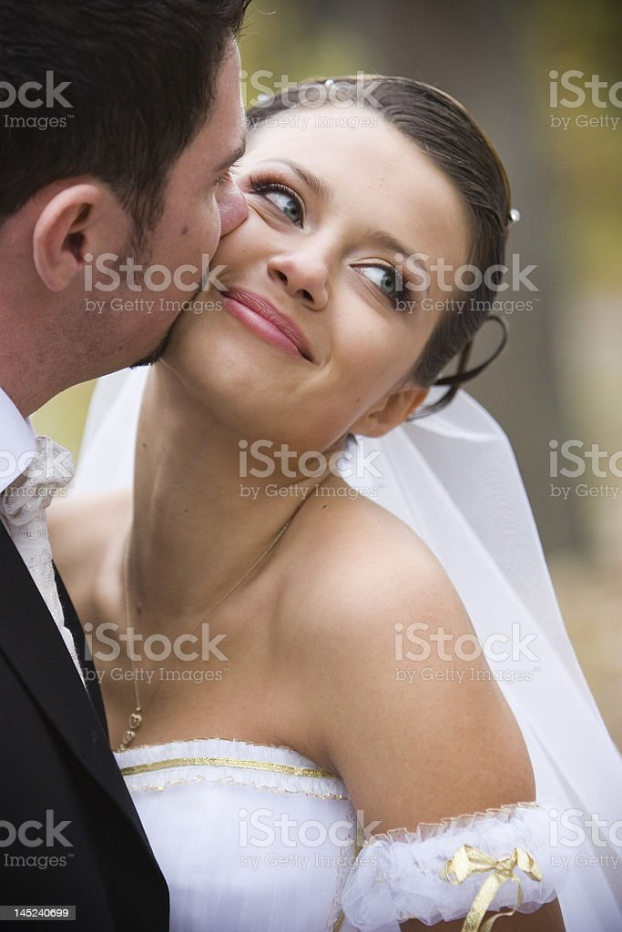 bride and groom share a kiss royalty-free stock photo