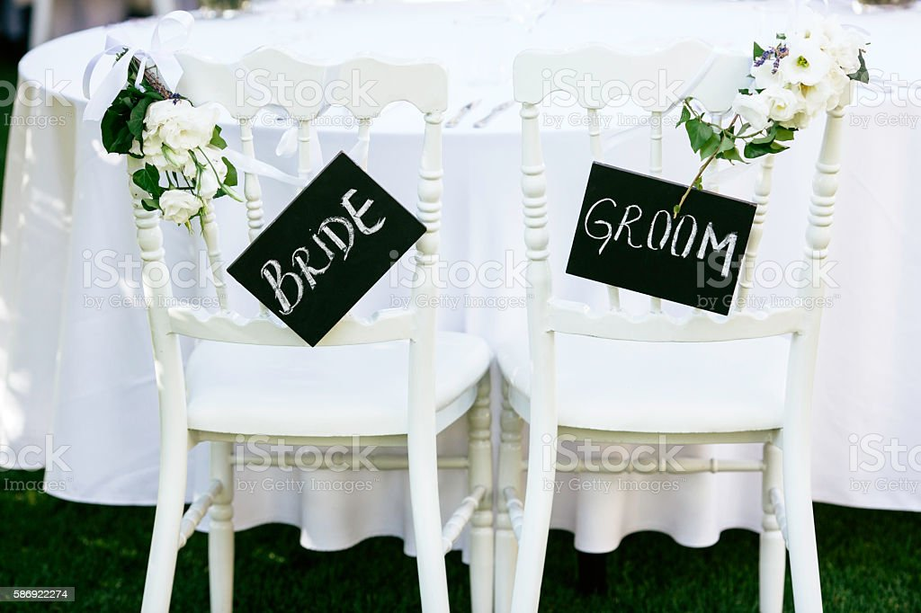 Bride and groom sign stock photo