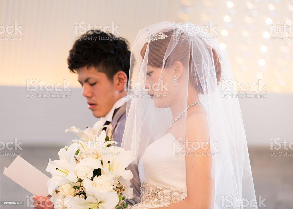 Bride and groom singing a song in chapel stock photo