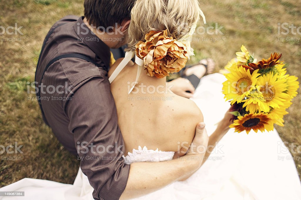 Bride and Groom Snuggling stock photo