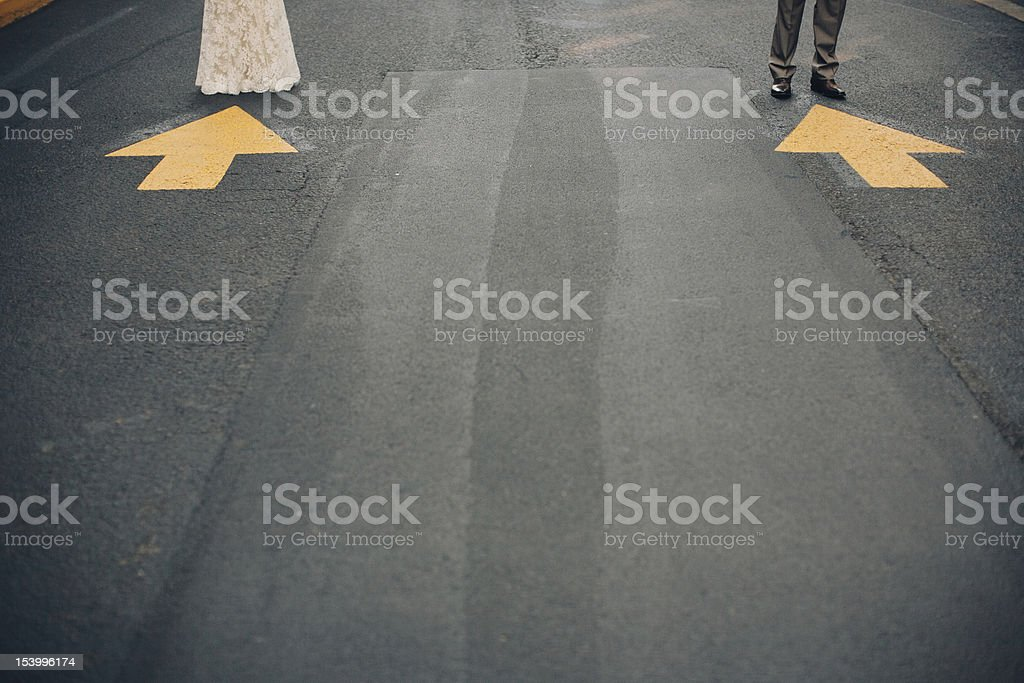 Bride and Groom Standing in The Street stock photo
