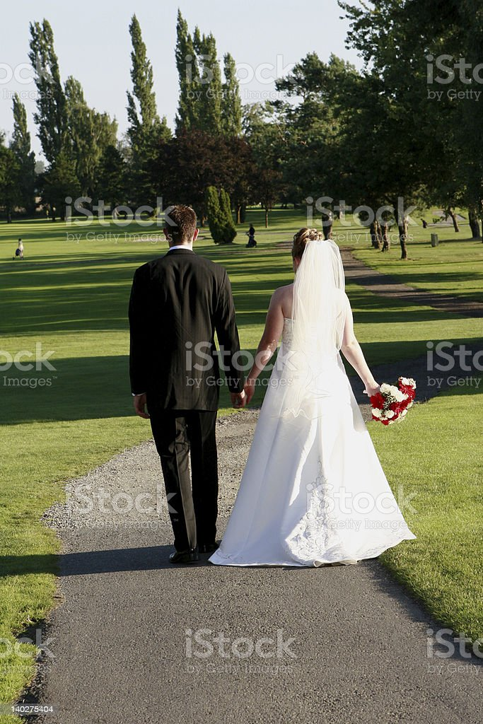 Bride and Groom starting down life's path. royalty-free stock photo