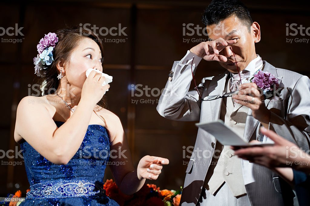 Bride and groom to be crying to read the letter stock photo