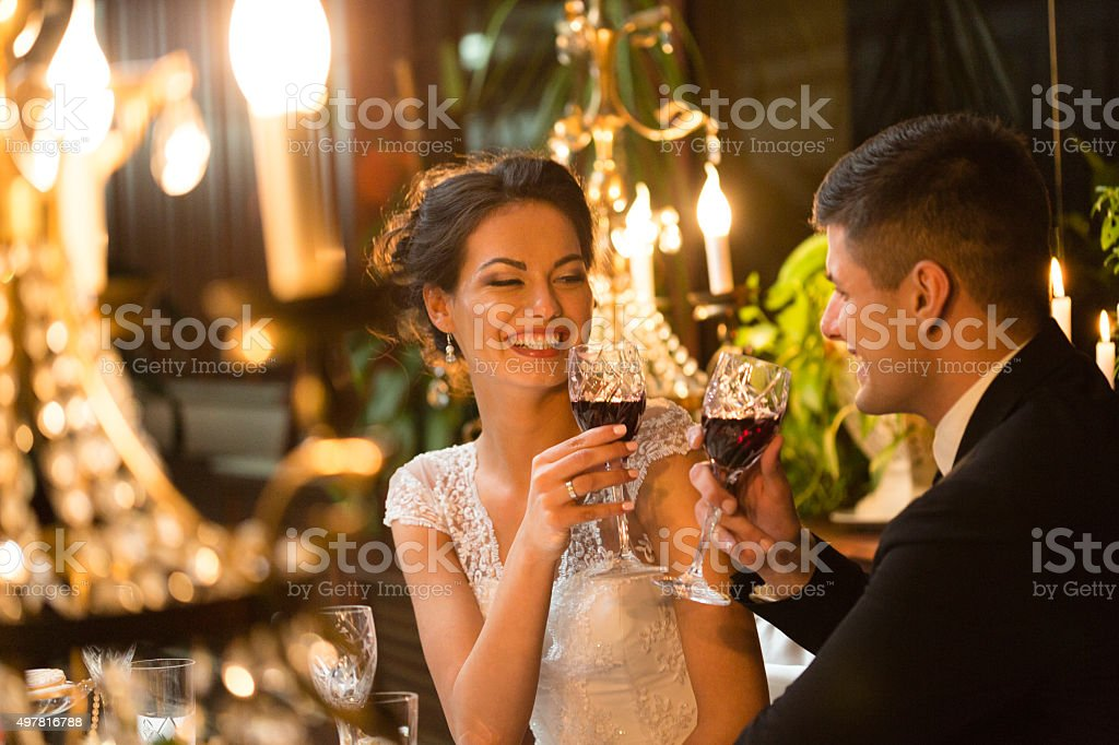 Bride and groom toasting at wedding stock photo