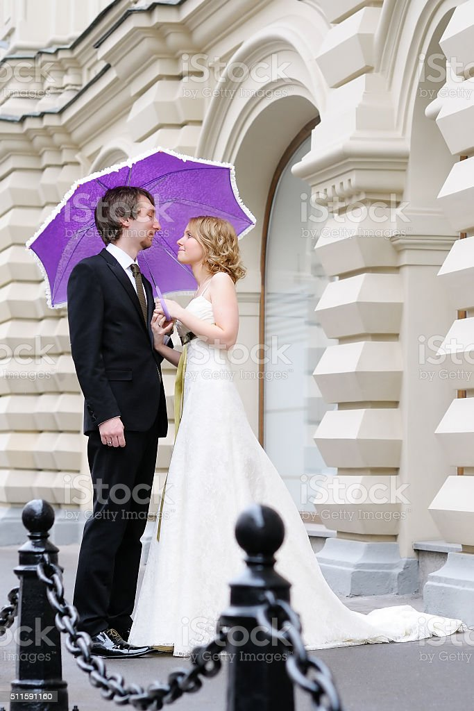 Bride and groom together outdoors stock photo