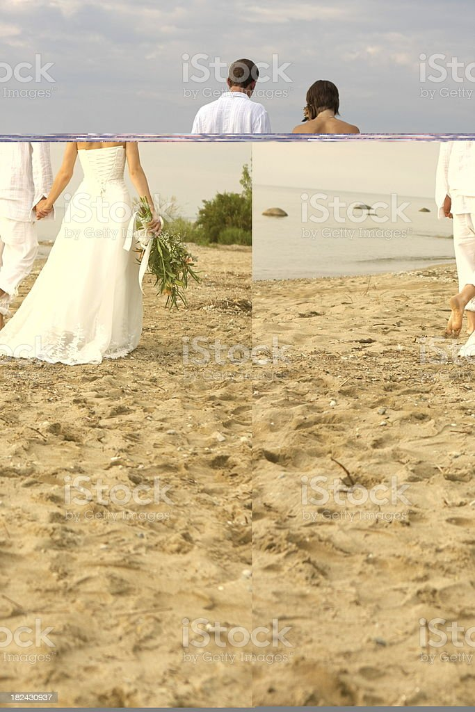 Bride and Groom Walking Along Beach royalty-free stock photo