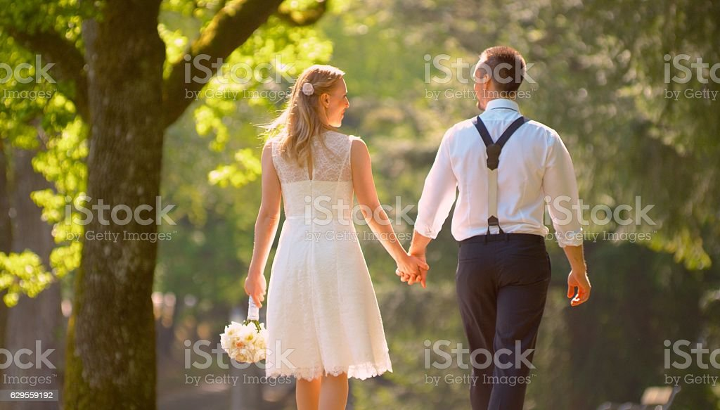 Bride and groom walking together stock photo