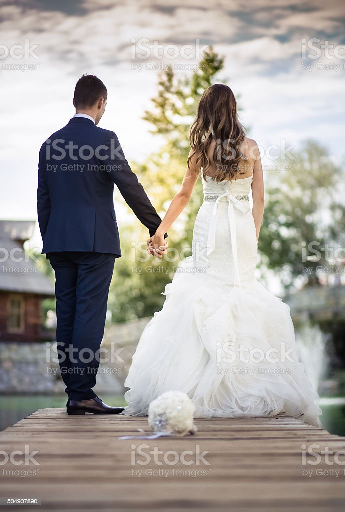 Bride and Groom watching the sunset stock photo