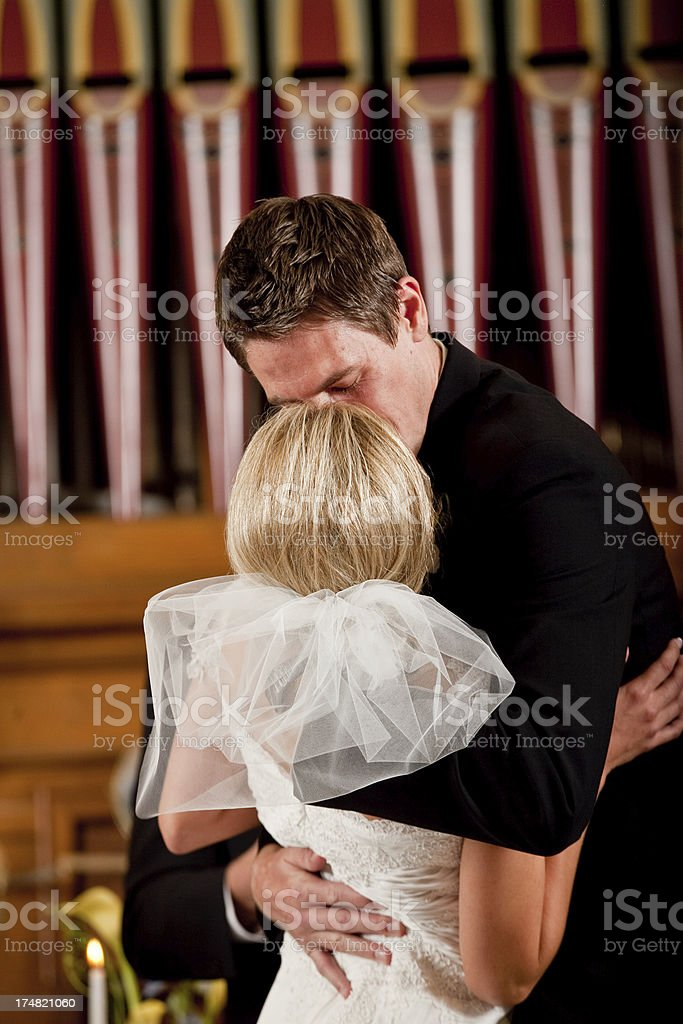 Bride and Groom Wedding Ceremony Kiss Inside Church royalty-free stock photo