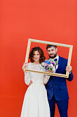 Bride and groom with a frame