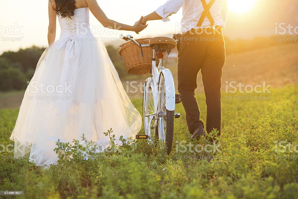 Bride and groom with a white wedding bike stock photo