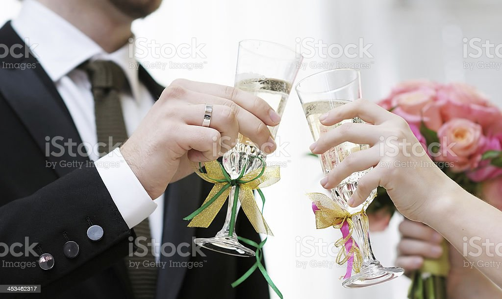 Bride and groom with champagne glasses stock photo