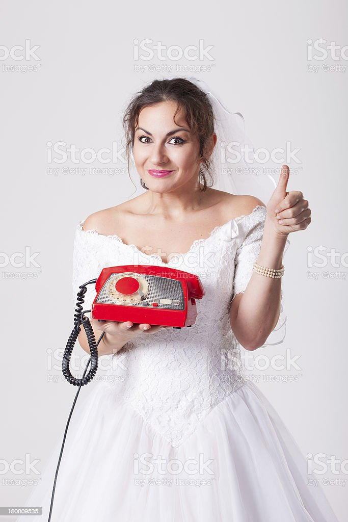 Bride and phone royalty-free stock photo