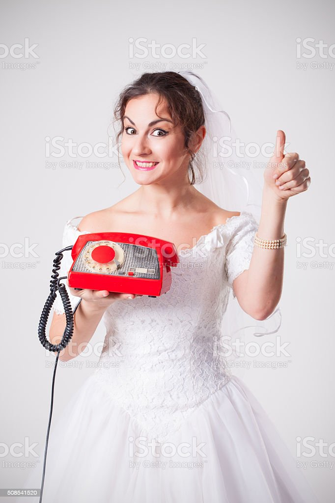 Bride and red phone stock photo