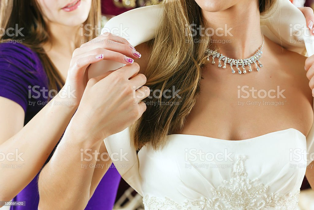 Bride at the clothes shop for wedding dresses stock photo