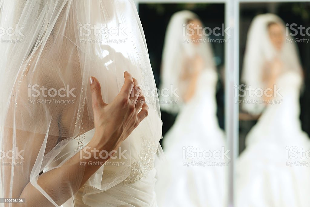 Bride at the clothes shop for wedding dresses royalty-free stock photo