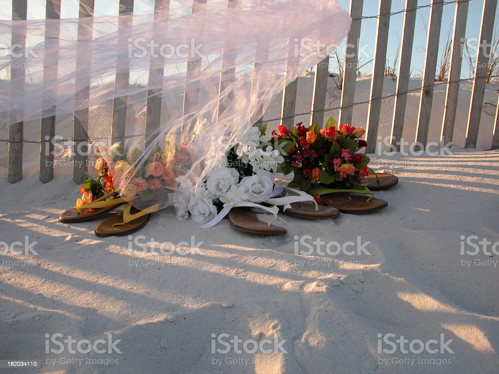 Bride Beach Shoes and Flowers stock photo