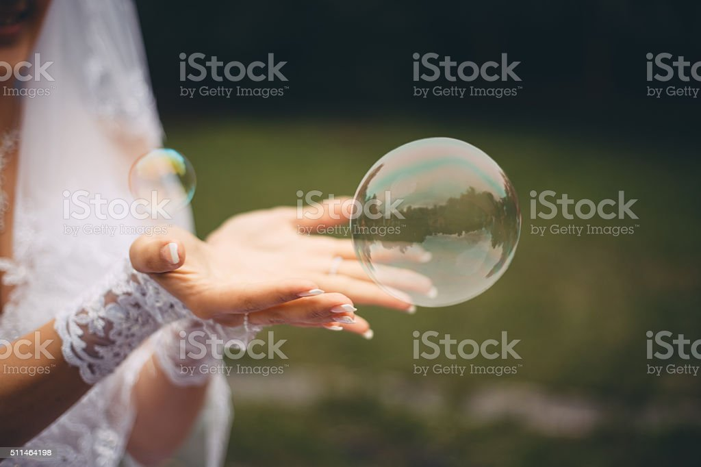Bride catching the soap bubble stock photo