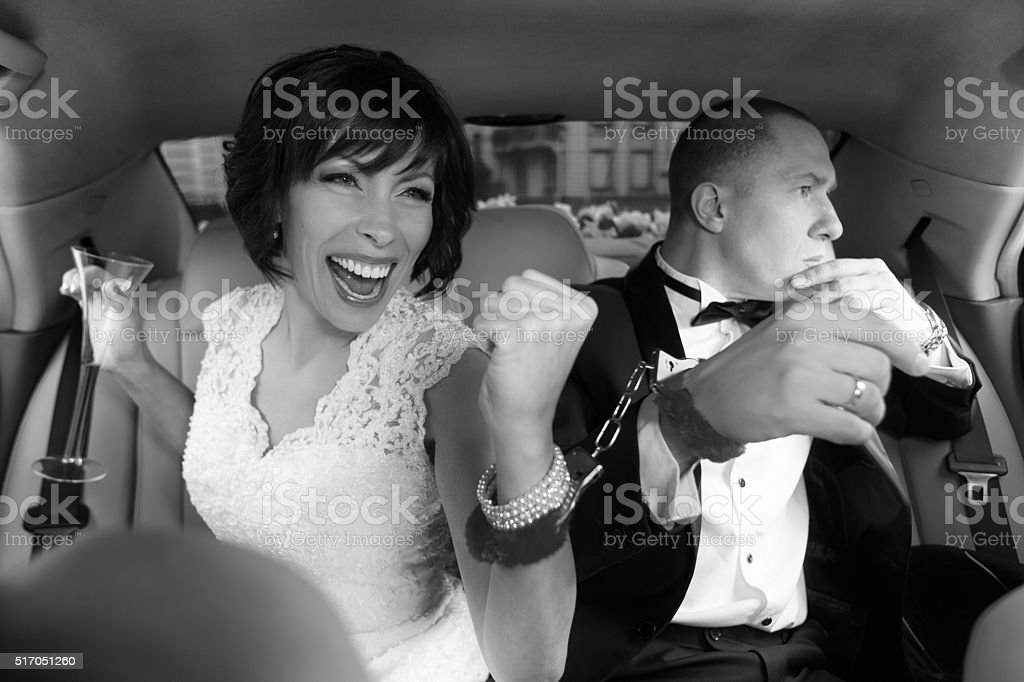 Bride celebrating her marriage with champagne stock photo